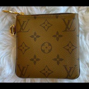 Authentic Louis Vuitton pouch in reverse monogram
